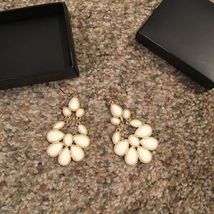 White chandelier earrings new never used AVON